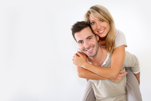 Cheerful,Couple,Standing,On,White,Background